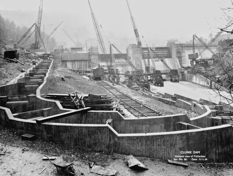 View from NE showing fishladder, in foreground, and dam, in background, under construction. Copy of 'Clunie Dam. General view of Fishladder. Ser. No. 86. Date: 9/11/49'.