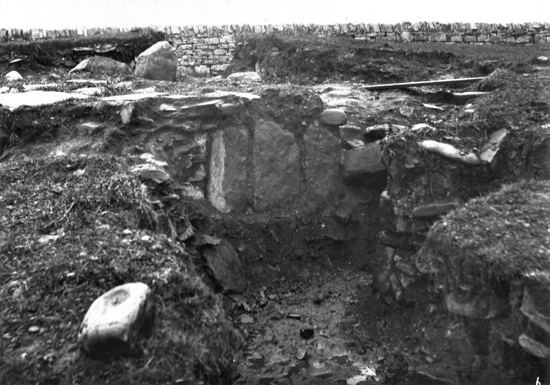 Excavation photograph showing a stone-built feature.