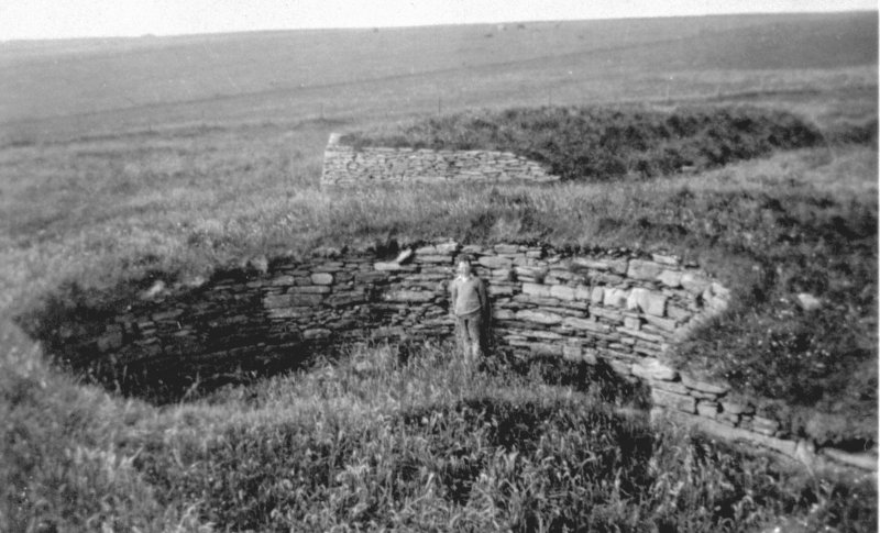 Scanned image of E 49350 - a photograph of a broch site.