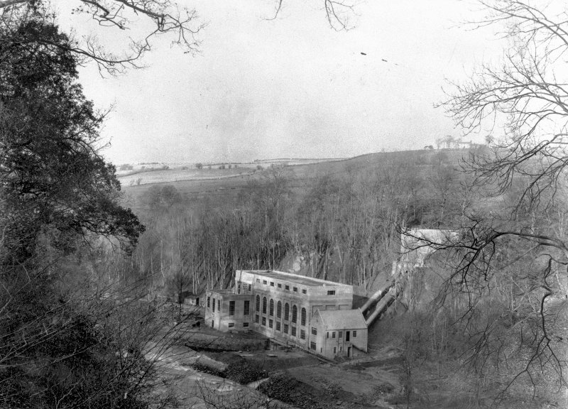 General view from S showing power station building, with surge tank up the slope behind it, Stonebyres hydroelectric power station.