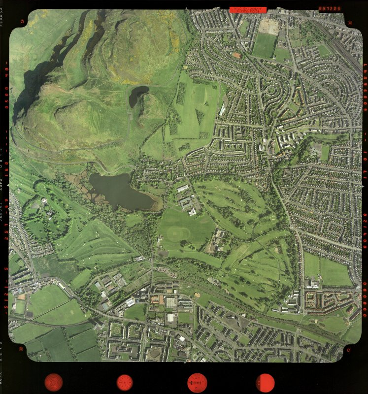 Scanned image of vertical aerial photograph.  Shows an area around Duddingston, Prestonfield and Arthur's Seat.