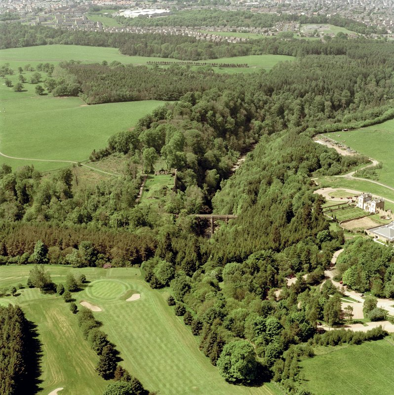 Oblique aerial view of Cadzow Castle, Chatelherault and the Duke's Bridge, taken from the E.