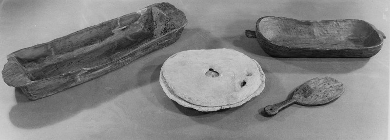 Scanned image of excavation finds, wood and pottery.