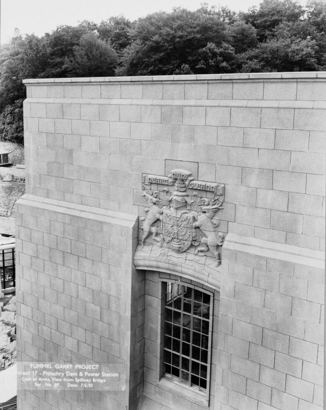 View of Tummel/Garry Project. Contract 17. Pitlochry Dam and Power Station. Coat of arms, view from spillway bridge. Scan of negative no. 89, Box 889/1