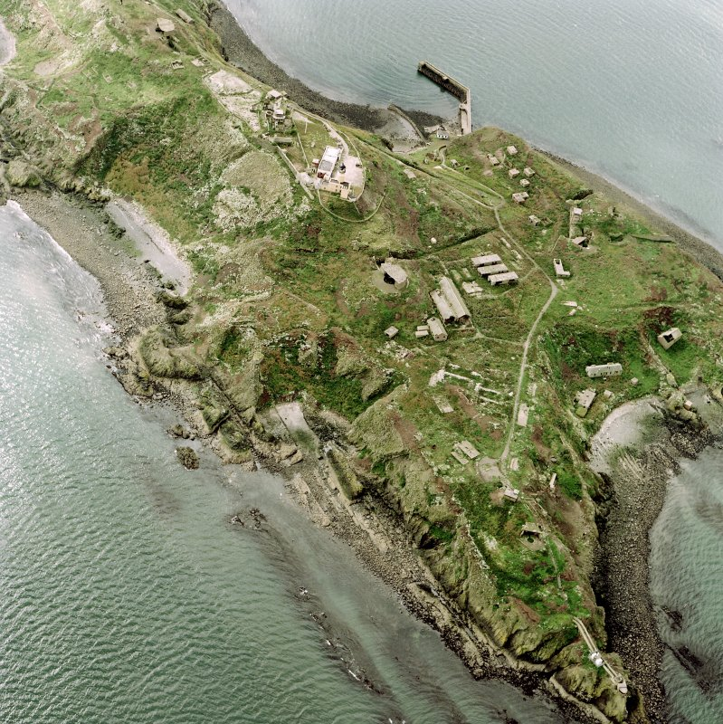 Oblique aerial view of Inchkeith Island centred on the defences, taken from the NNE.