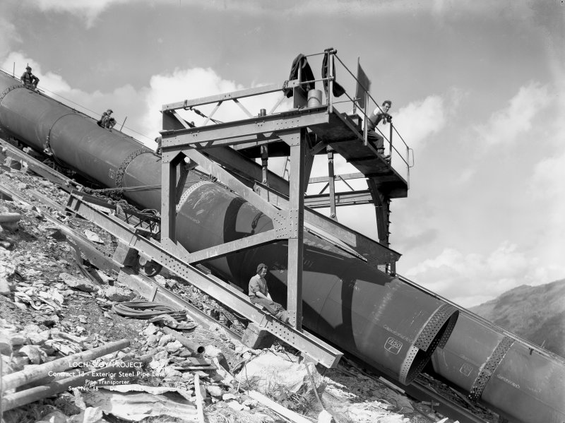 View of exterior steel pipeline and pipe transporter, Loch Sloy Project, Contract 13, in 1949.
