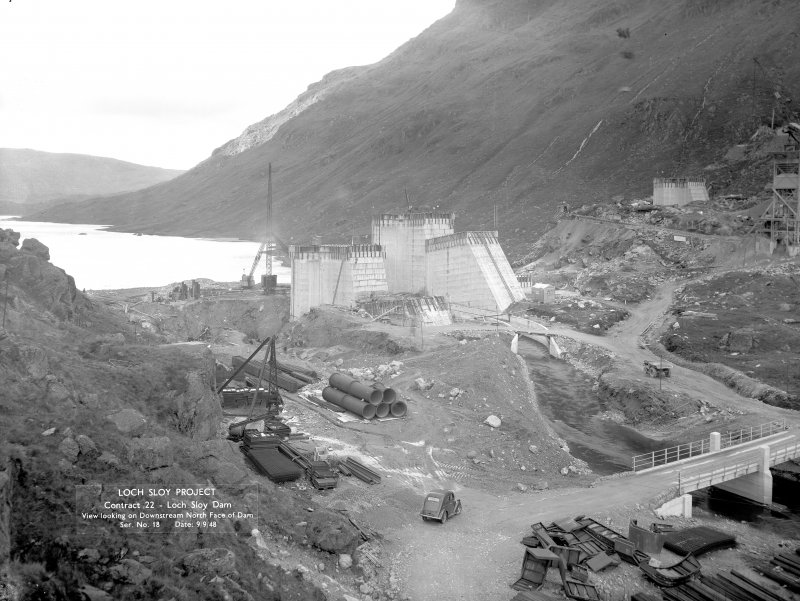 Loch Sloy Project, Contract 22- Loch Sloy Dam. View looking on downstream north face of dam. Scanned image of negative no. 18, Box 883.
