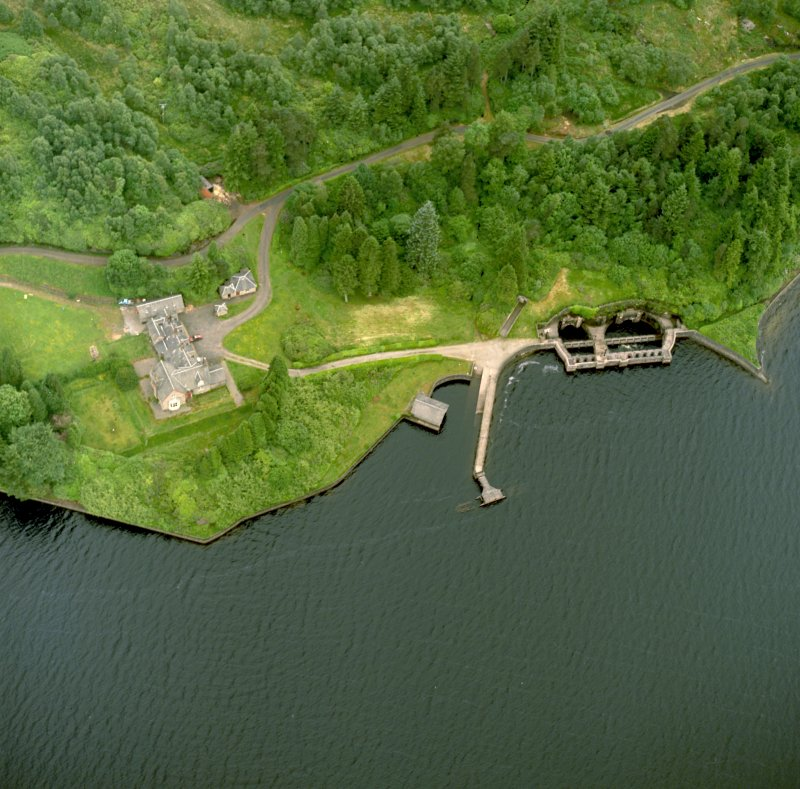 Oblique aerial view centred on Royal Cottage with the pier, boathouse and aqueduct intakes adjacent, taken from the NE.
