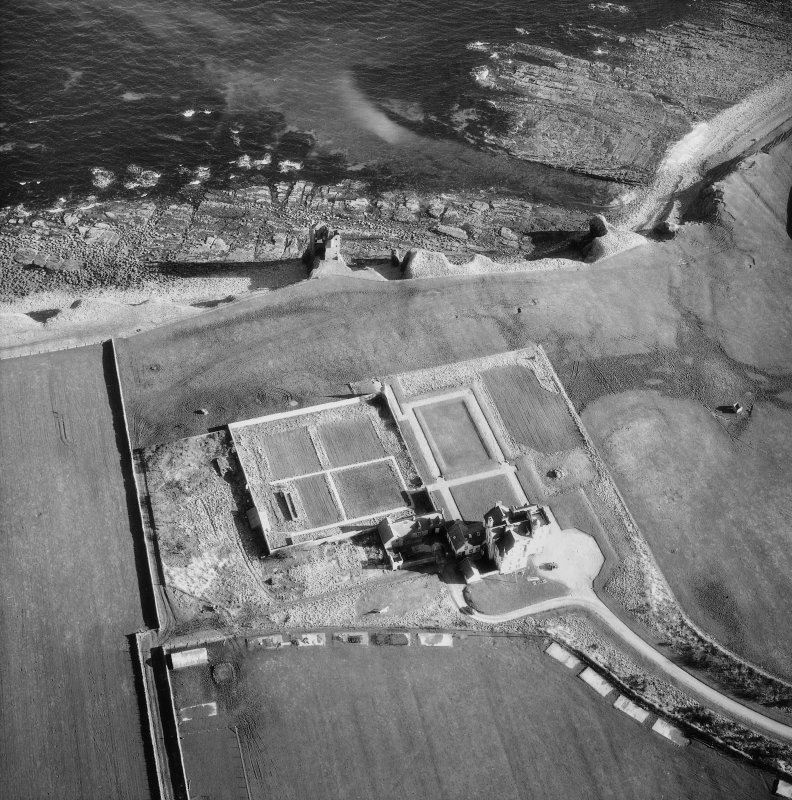 Oblique aerial photograph showing old and new castles and nissen huts