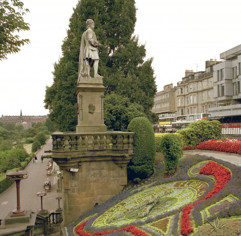 View of floral clock and statue of Alan Ramsay from east