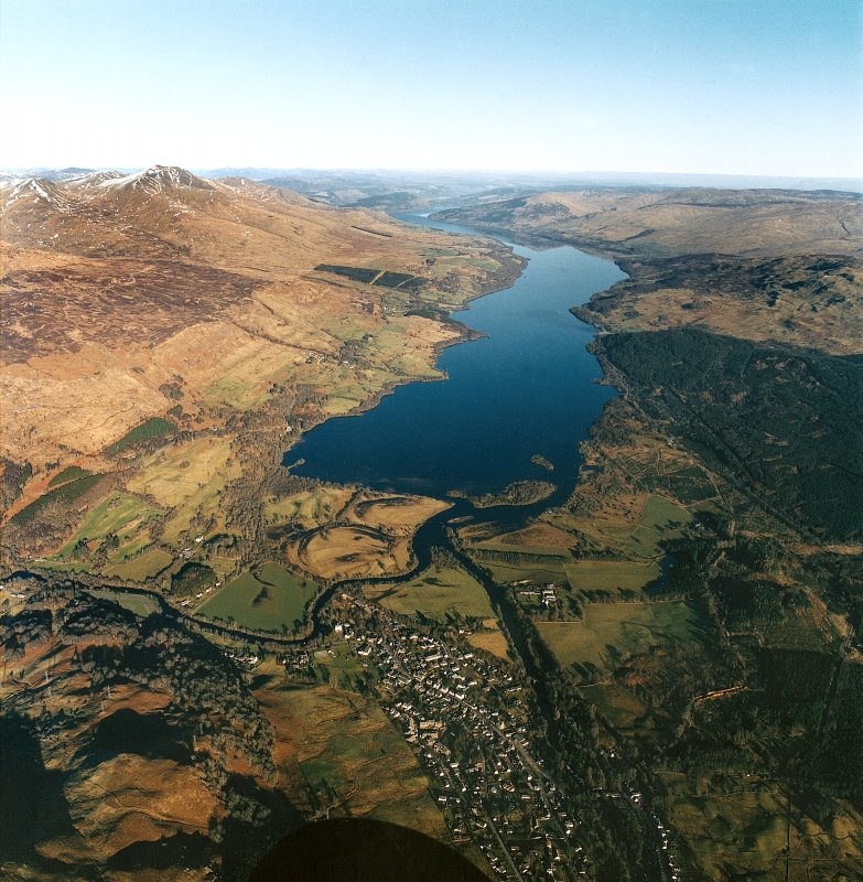 Oblique aerial view centred on Loch Tay with Killin village adjacent, taken from the SW.