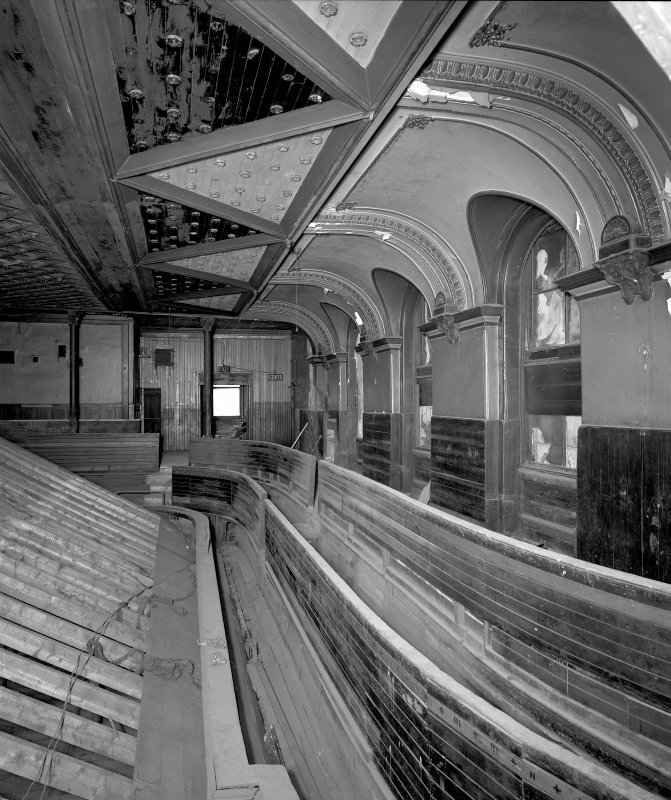Interior. View of second floor auditorium balcony, W side, from S.