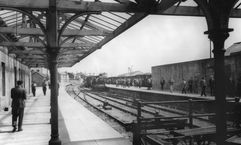 Photograph showing general view of station platforms from NW.