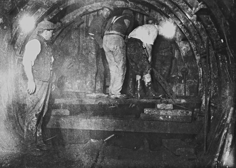 Placing concrete liner segments in position from surge tank end. Under gardens.. Photographic copy of Plate 50, Volume 198, PA 123.