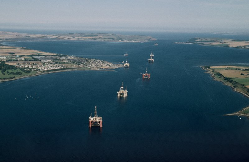 Oblique aerial view centred on oil drilling platforms in the Cromarty Firth with Invergordon adjacent, taken from the W.