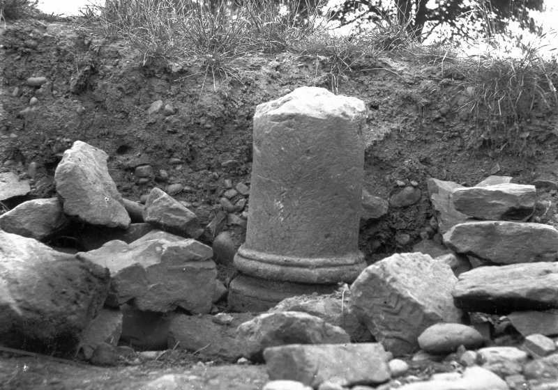 Excavation photograph showing column drum and base, taken during the James Curle excavation 1905-1909.