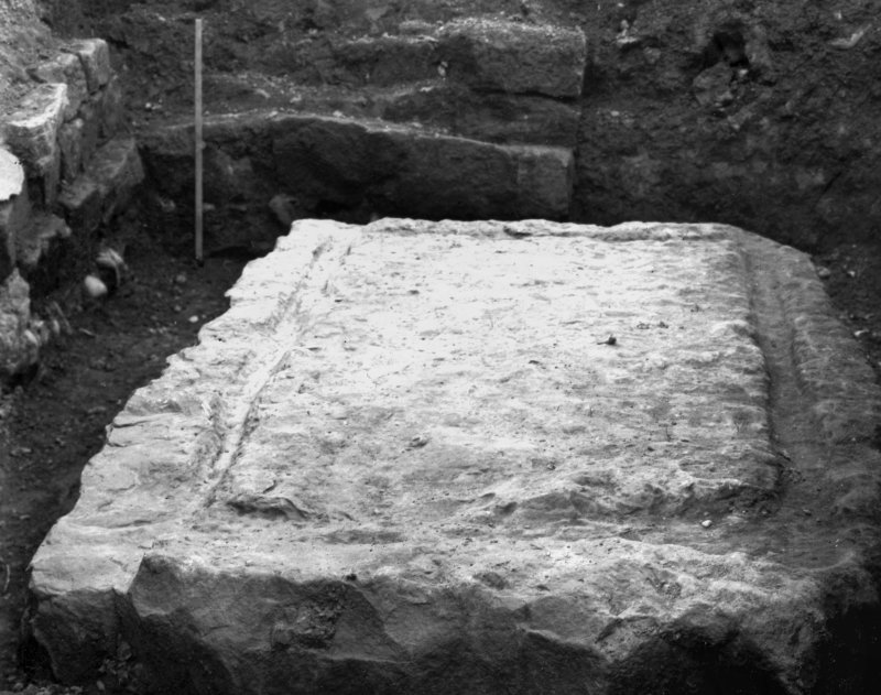 Excavation photograph showing large block at corner of courtyard, taken during the James Curle excavation 1905-1909.