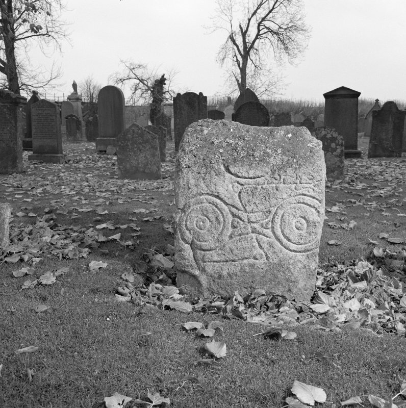 View of face of Pictish symbol stone in Inverurie churchyard.
