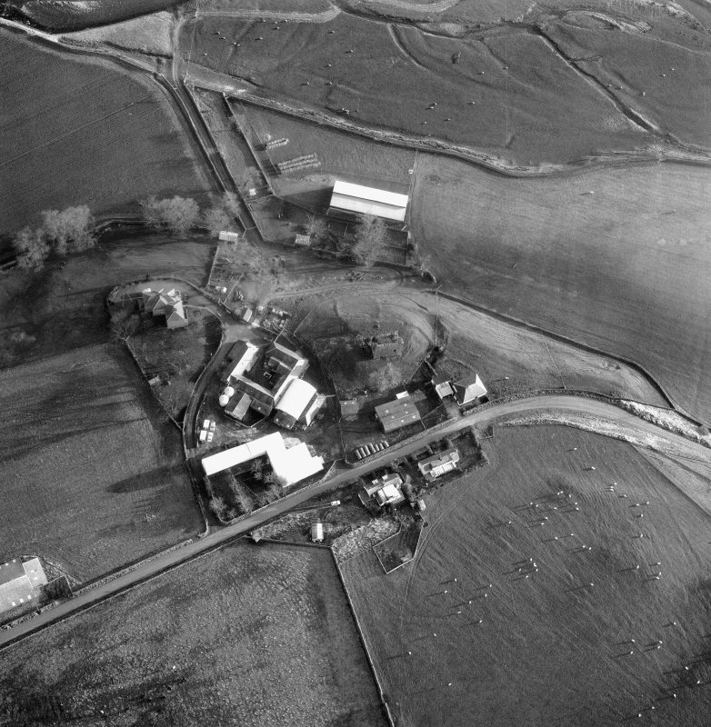 Scanned image of oblique aerial view centred on tower from W.