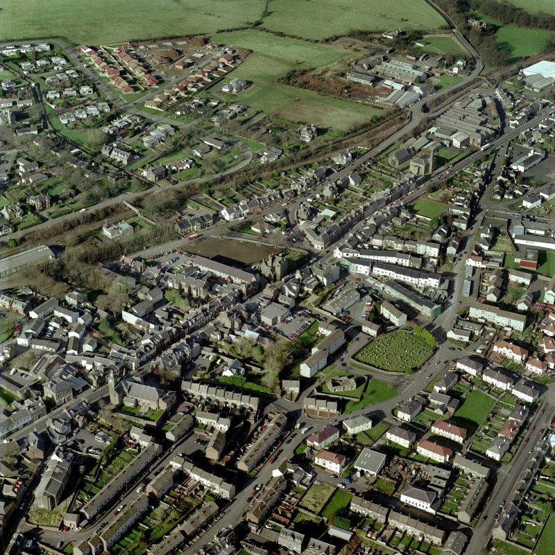 Scanned image of an oblique aerial view centred on the SE area of the town, taken from the S.