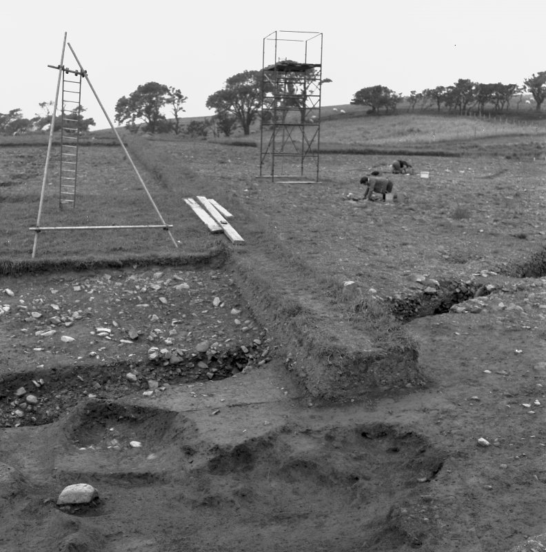 General view of excavations, including scaffolding for site photography.