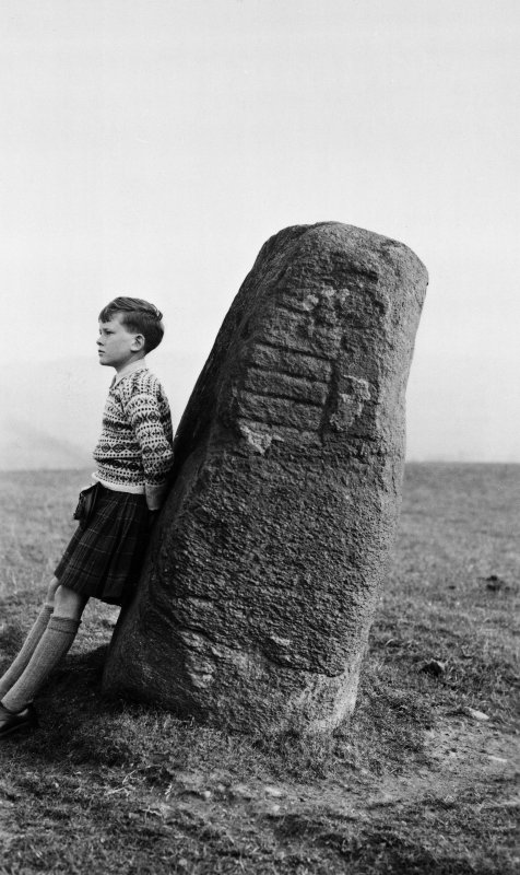 Digital copy of photograph of symbol stone, with kilted boy (5 feet 8 inches high) as scale.