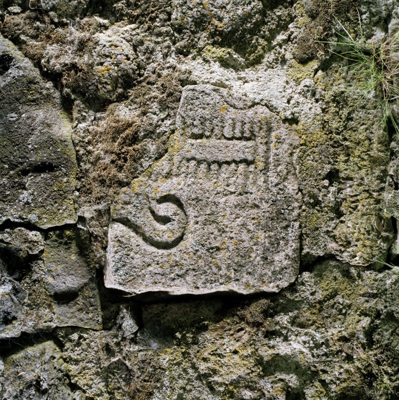 Fragment of cross-slab built into wall. Digital copy of E 56809