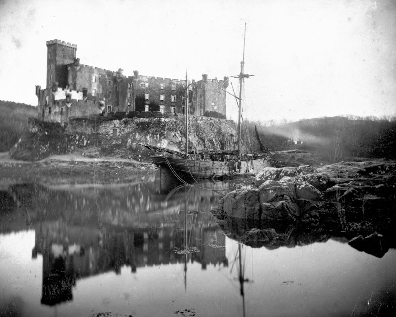 General view of Dunvegan Castle from west with sailing ship at anchor.