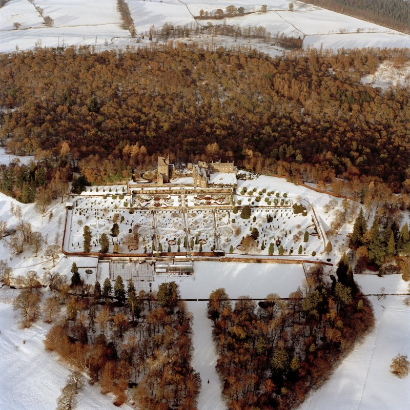 Oblique aerial view of Drummond Castle in the snow, taken from the South South-East, taken in 1996.
