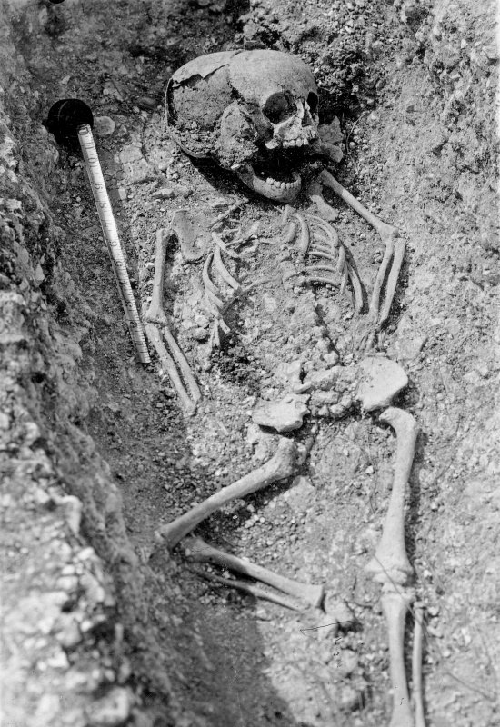 Digital copy of excavation photograph showing a single child interment.