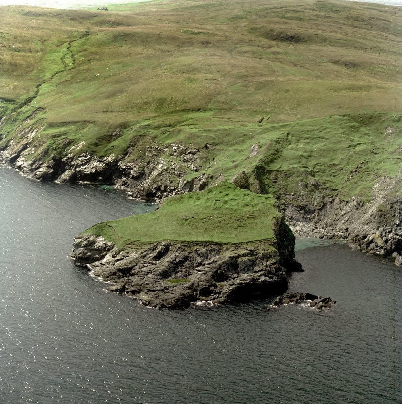 Oblique aerial view centred on the remains of the monastic settlement, taken from the E.