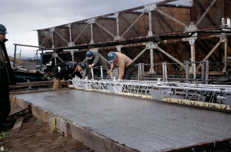 Tests on screeding a trial panel of side span roadway concrete in south working area. Copy of original 35mm colour transparency. Survey of Private Collection