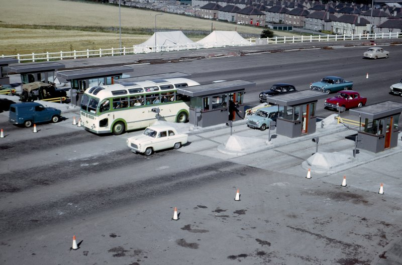 The opening to traffic. View of toll booths from the Forth Road Bridge Administration Block. Copy of original 35mm colour transparency. Survey of Private Collection