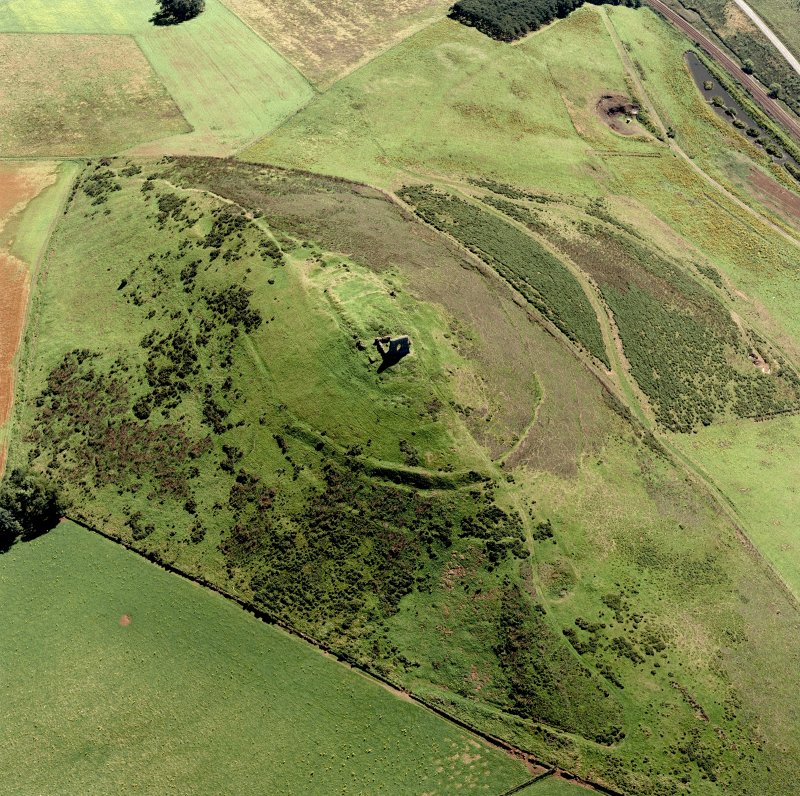 Oblique aerial view of Dunnideer.