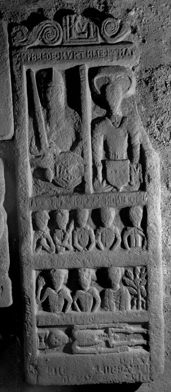 Interior. Scanned image of general view of tomb slab with couple, their sons and daughters, and a skeleton and hourglass.