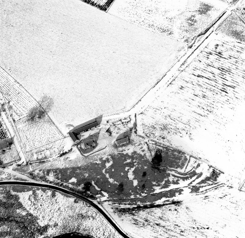 Scanned image of Badenyon, oblique aerial view, taken from the SSW, centred on the site of Badenyon Castle and the farmsteading.