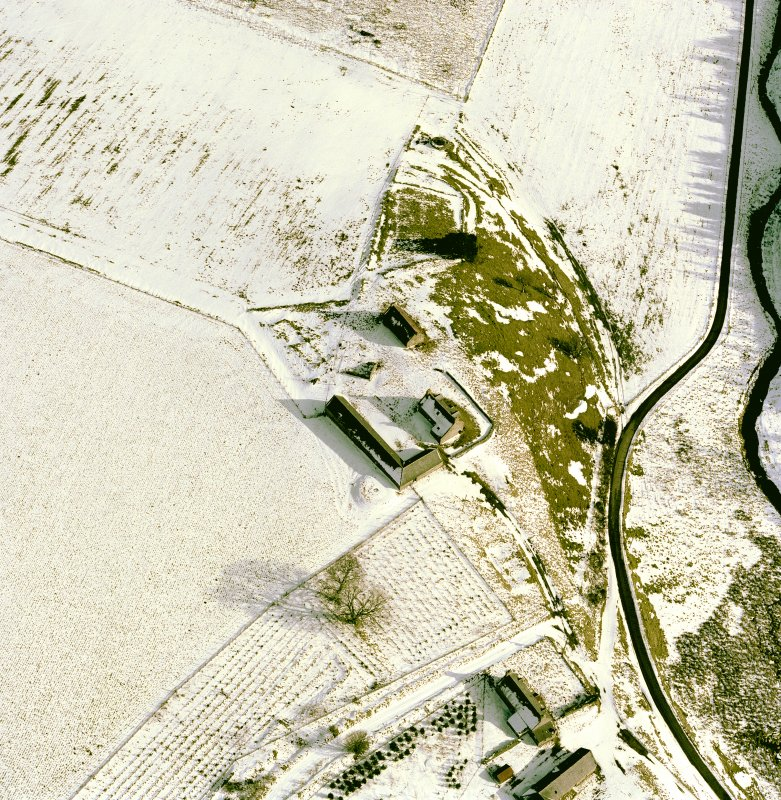 Scanned image of Badenyon, oblique aerial view, taken from the NW, centred on the site of Badenyon Castle and the farmsteading.