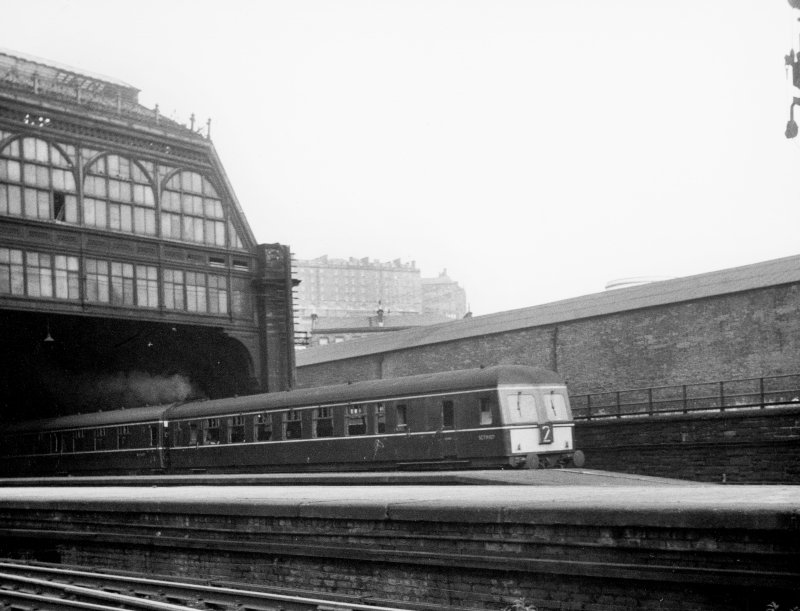 Scanned image of view from platform looking east to Lothian Road showing part of roof, train and Castle in background