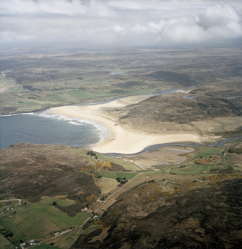 Oblique aerial view centred on Torrisdale Bay with the village of Bettyhill adjacent, taken from the WNW.