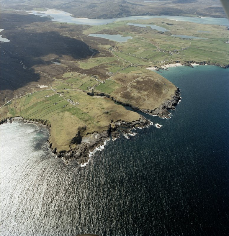 General oblique aerial view looking across the crofting townships, cave and the remains of the radar station towards the Kyle of Durness, taken from the E.
