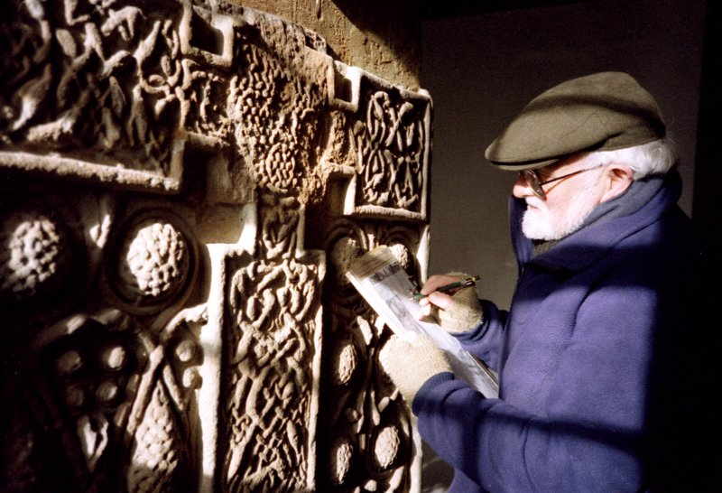 Ian G Scott, draughtsman, recording the Nigg Pictish cross-slab.