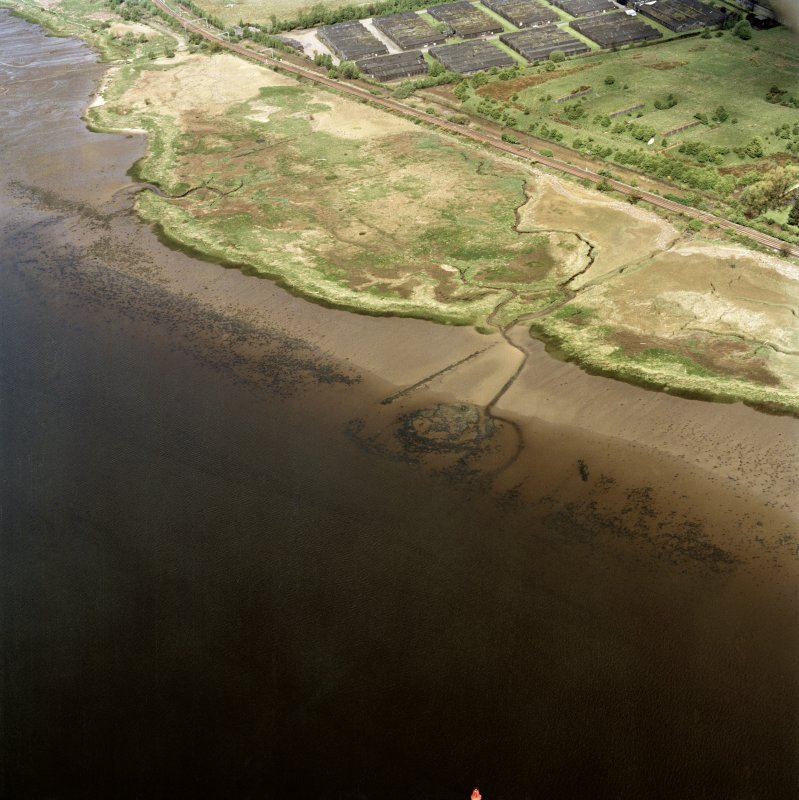 Oblique aerial view centred on the remains of the Dumbuck crannog, taken from the SE.