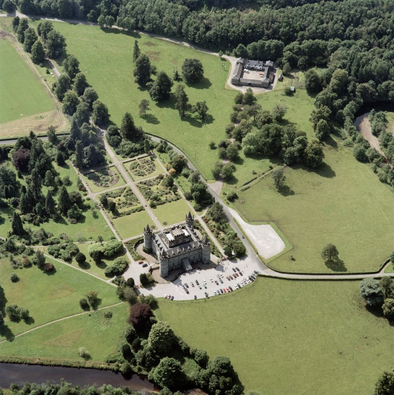 Oblique aerial view centred on the country house and garden with farmhouse, farmsteading and stables adjacent, taken from the ENE.