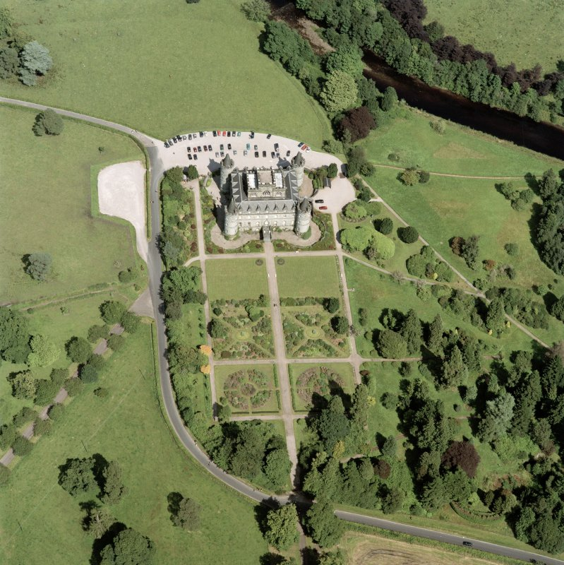 Oblique aerial view centred on the country house and garden, taken from the SW.
