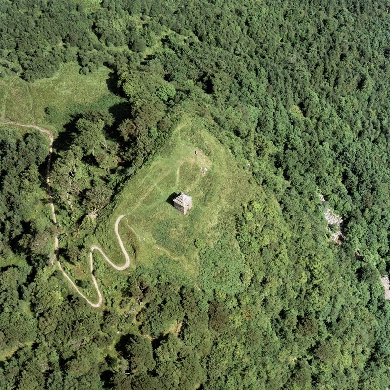 Oblique aerial view centred on the tower and remains of the fort, taken from the W.