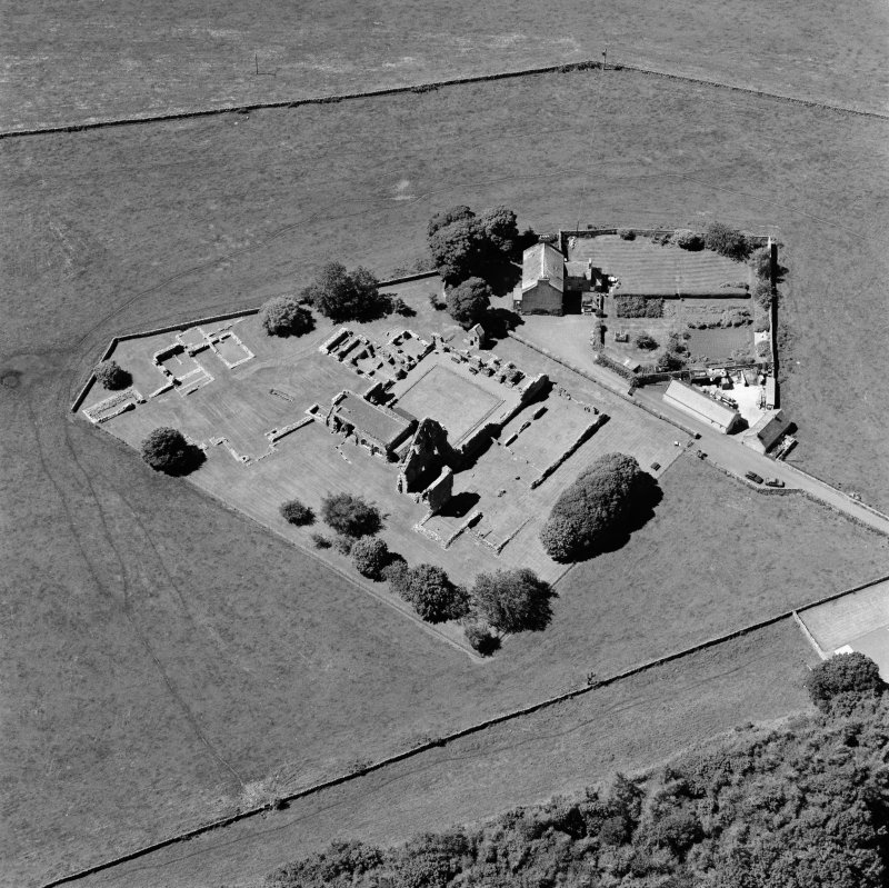 Oblique aerial view centred on the remains of the abbey and abbot's house, taken from the E.