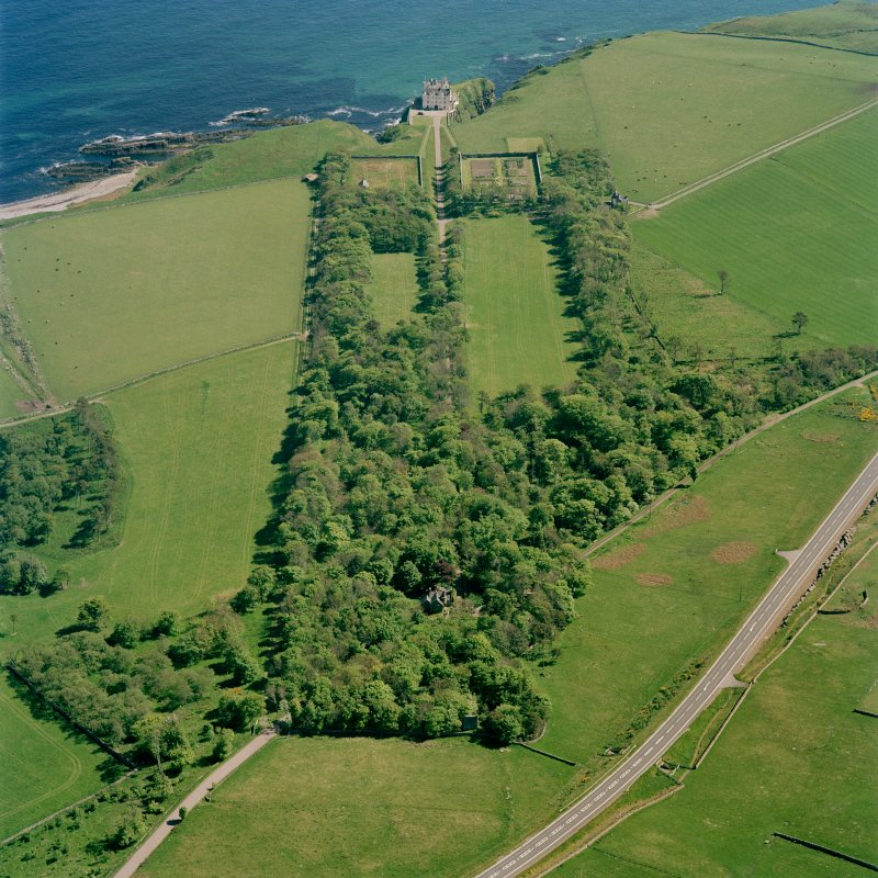Oblique aerial view of Dunbeath Castle and grounds from NW.