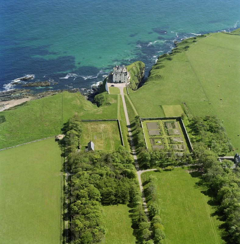 Oblique aerial view of Dunbeath Castle and walled gardens from NW.