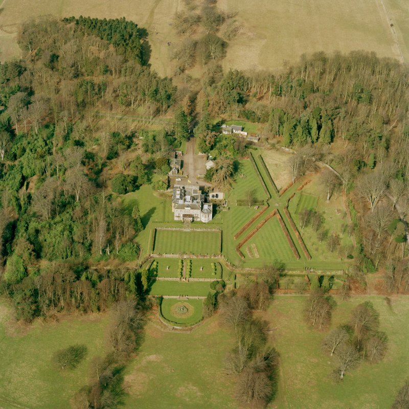 Oblique aerial view of Charleton House centred on a country house, taken from the SSE.