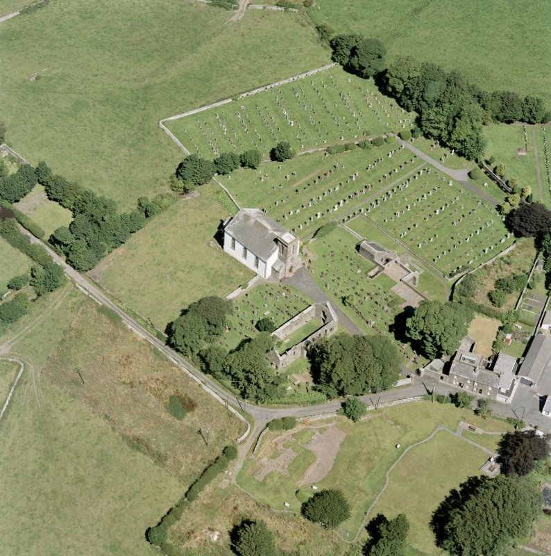 Oblique aerial view centred on Whithorn church, burial ground and remains of the priory, taken from the SSW.